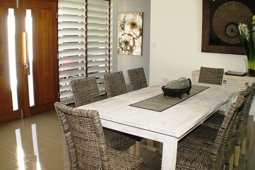 Dining room overlooking the pool, which is beachfront