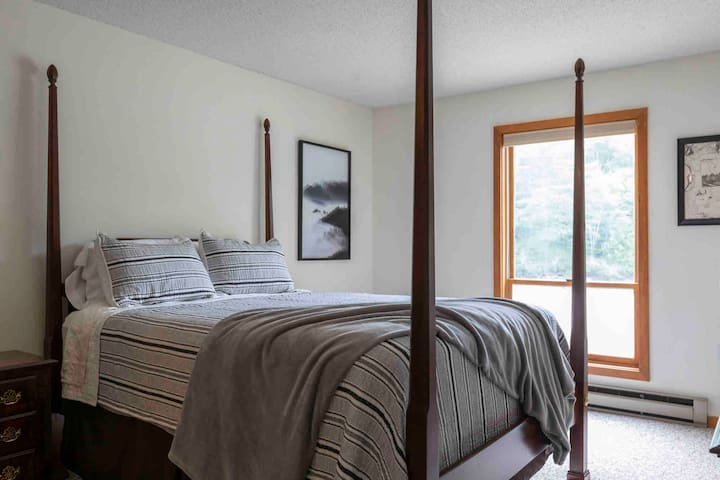 Master bedroom with view of the Pemi and Loon.