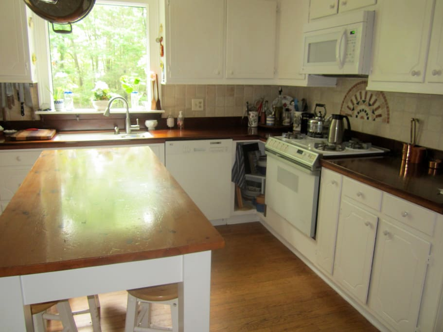 Kitchen with a gas stove, griddle top and a new double oven