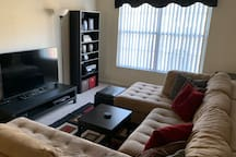 Lounge around on our massive sectional couch, and watch movies/shows on the high resolution big screen TV. Blankets can be found inside the storage ottoman, and reading lamps are provided behind both corner ends of the couch.