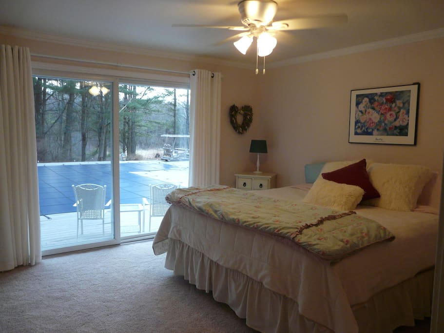 Master Bedroom with adjoining Bath and sliding door to access pool and deck