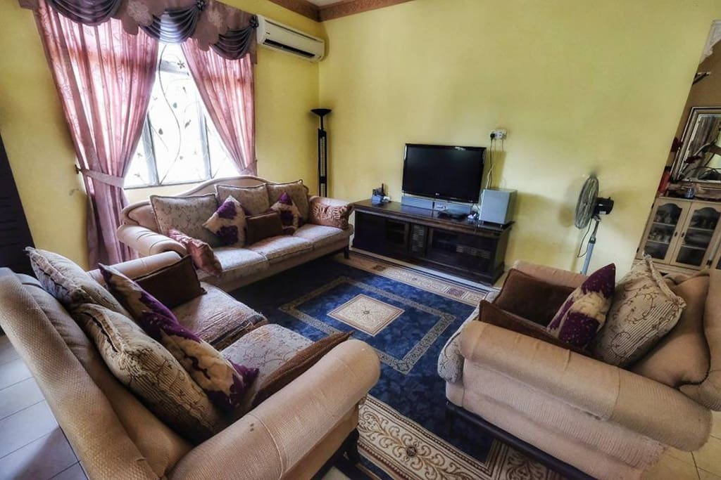 "Living Room is very spacious, complete with home theatre system, a 42"" LCD TV with blue-ray disc player, and 2hp air-condition"