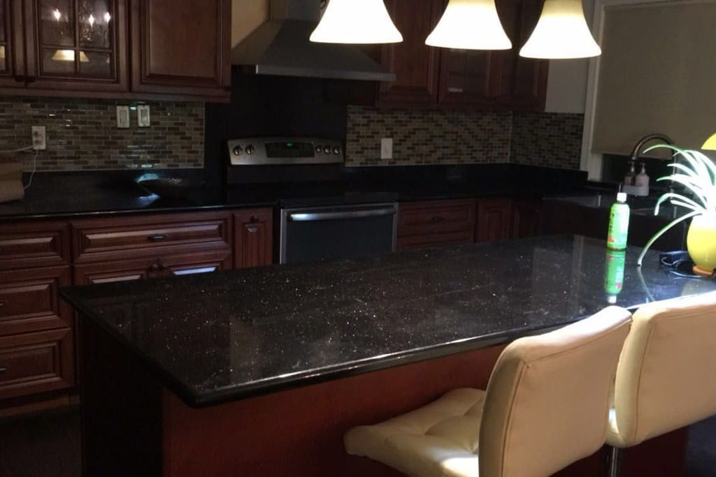Full kitchen with island bar