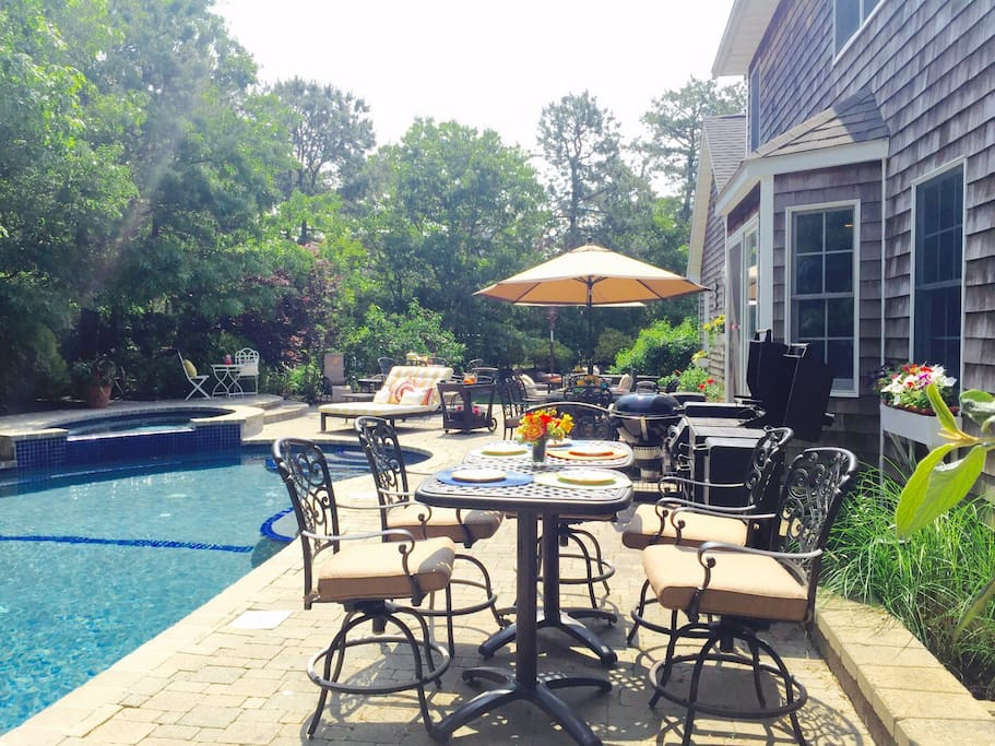 The patio area is equipped with  two charcoal grills, one propane grill, a searing station and a smoker along side of plenty of dining and sun bathing chairs.