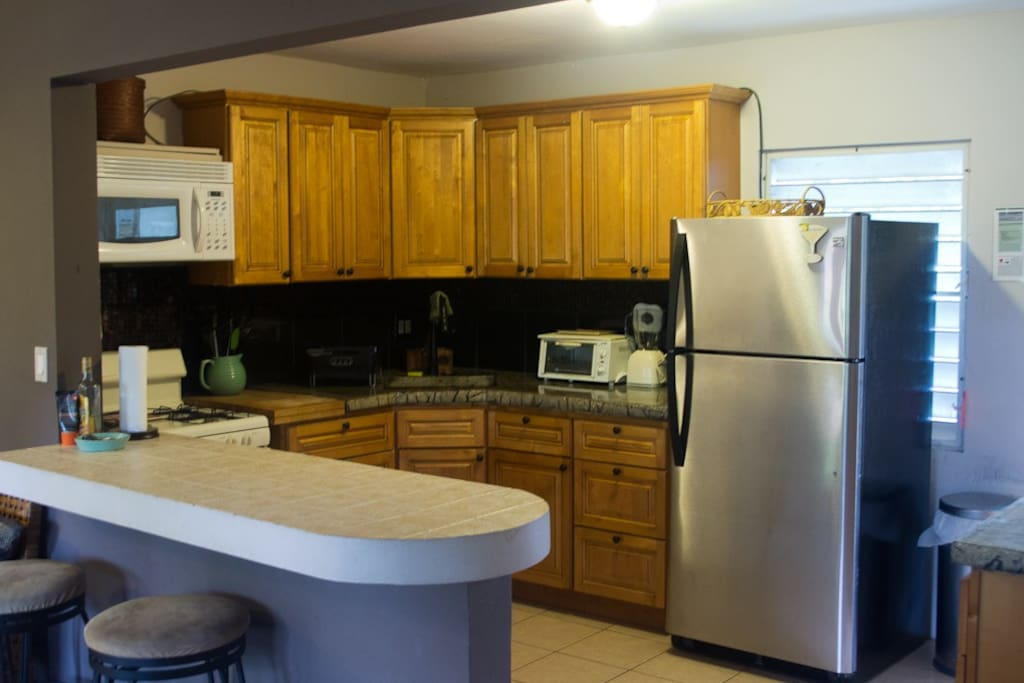 Fully stocked kitchen with custom concrete countertops hand crafted by owner.