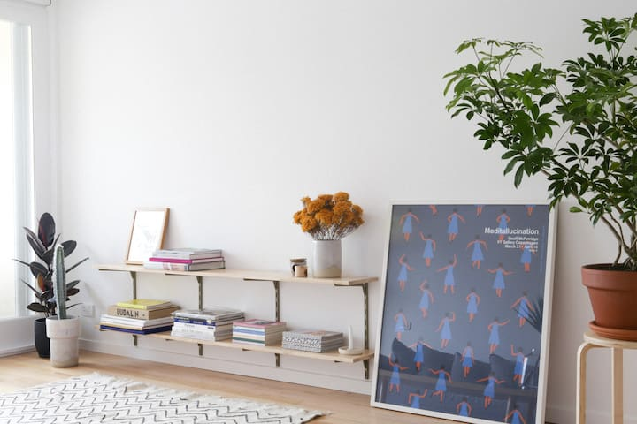 Plants, books, art and a comfy couch