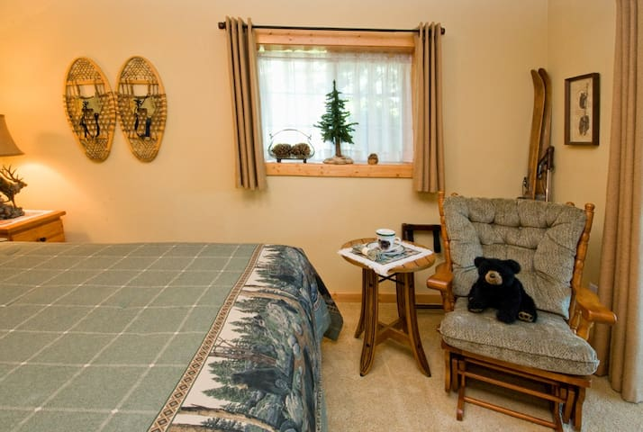 Cozy lodge décor with comfy glider.