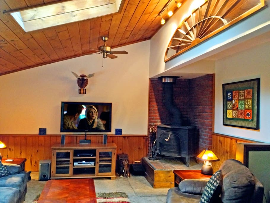 Relax in the living room. Start a fire in the wood burning stove. Put on Netflix, cable or a DVD.