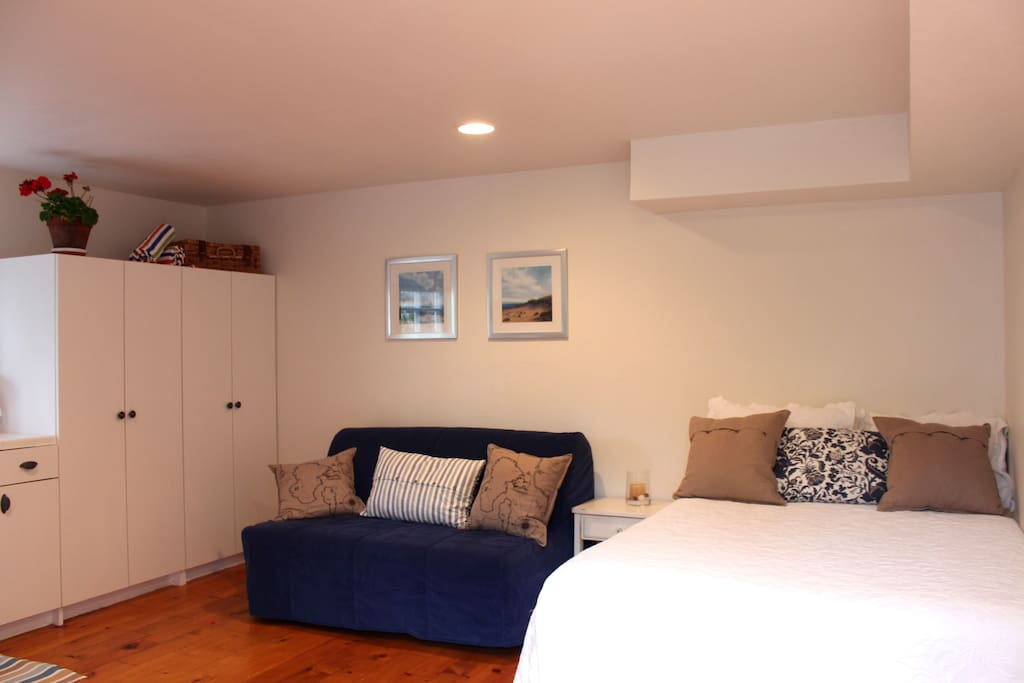 Sleeping area with comfortable pullout and bed.  Closet/storage space with beach gear.