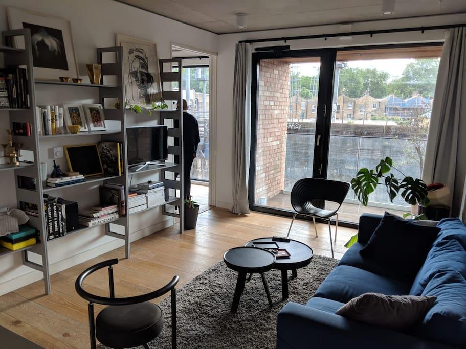 open plan living space with floor to ceiling siding door.