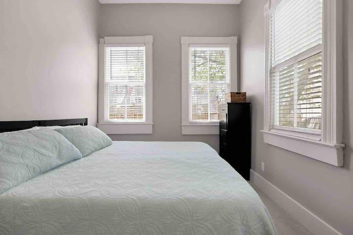 King-sized bedroom boasts plenty of natural light.