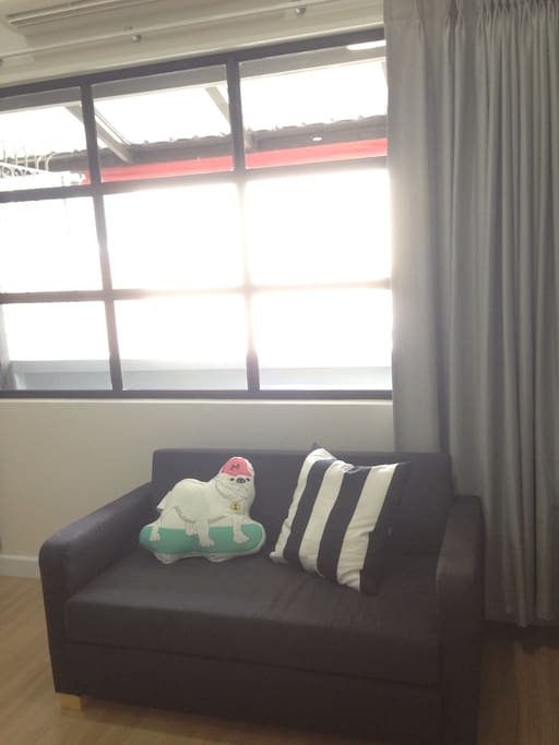 Large window with city view this loveseat sofa can adjust to be an extra ed