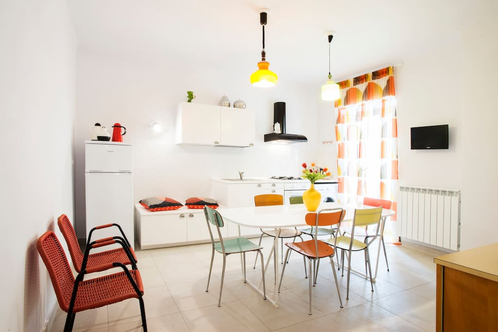 The kitchen, spacious and fully equipped. You will be able to prepare your meals and feel at home.