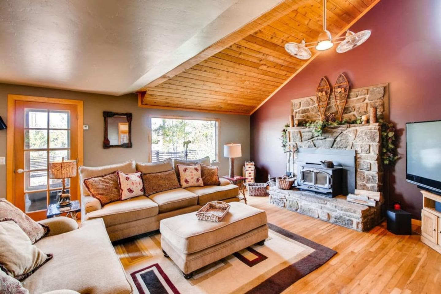 Open, inviting, comfortable living room with working log burning fireplace.  Tons of natural light.