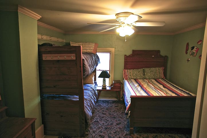 2nd bedroom 2 single beds and 1 double bed