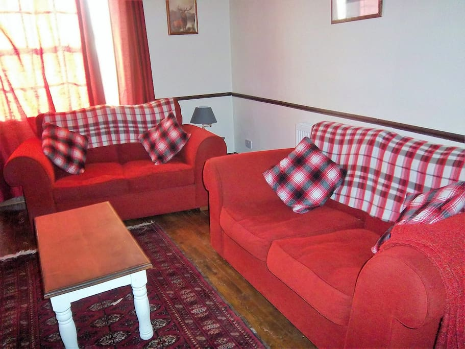 Comfortable lounge area, with TV, central heating and log burning stove.