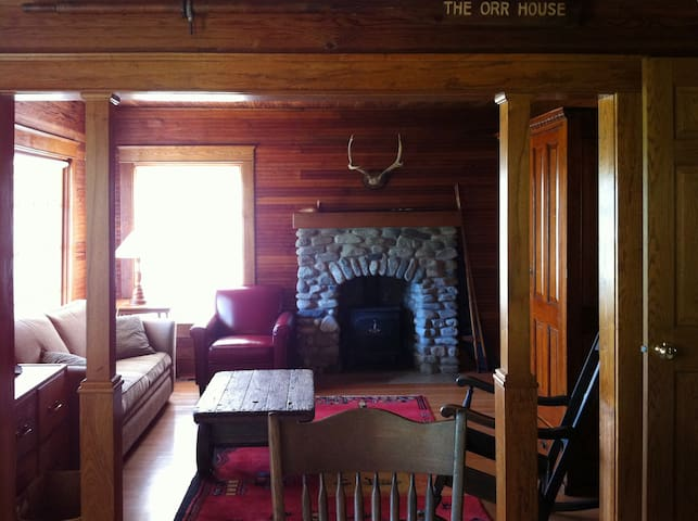The livingr oom with its beautiful river rock fireplace, made by a local stone mason. There is a large screen TV and DVD player in the armoire.