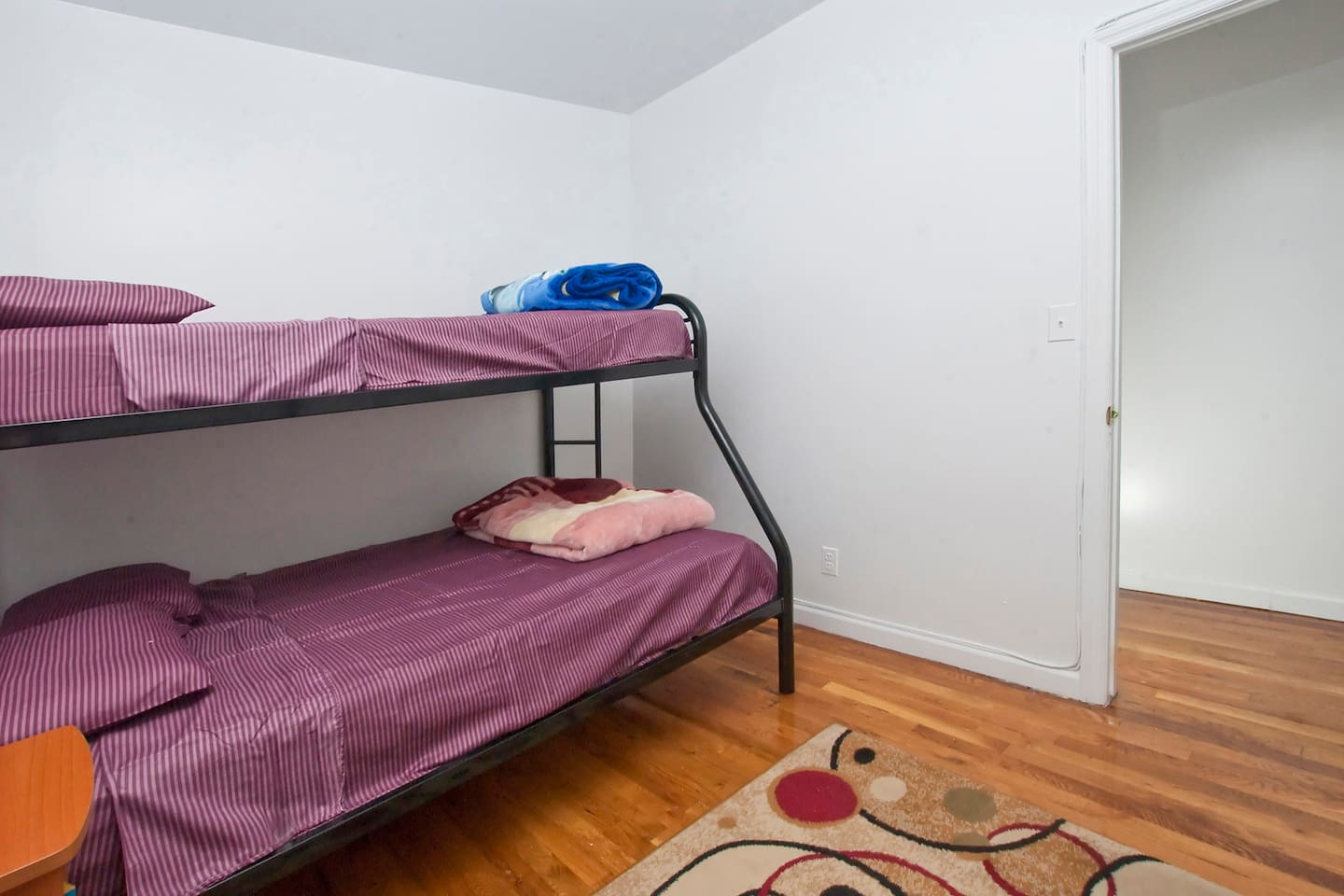 here is your room. Bottom bunk can fit 2, top bunk fits 1. the ottoman/cot you see on the left is no longer available (it was damaged by a guest), The room only has the bed... sleeps 3 comfortably... you are welcome to fit more if you see fit