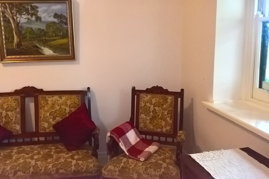 Couch and armchair in Queen bedroom