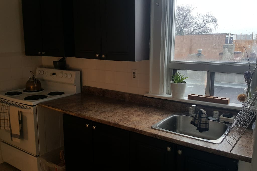 Our kitchen which has a beautiful view looking East (including clear view of CN tower).