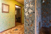 Decorated wall with wood and stones.