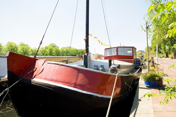 Classic houseboat in the city center of Amsterdam