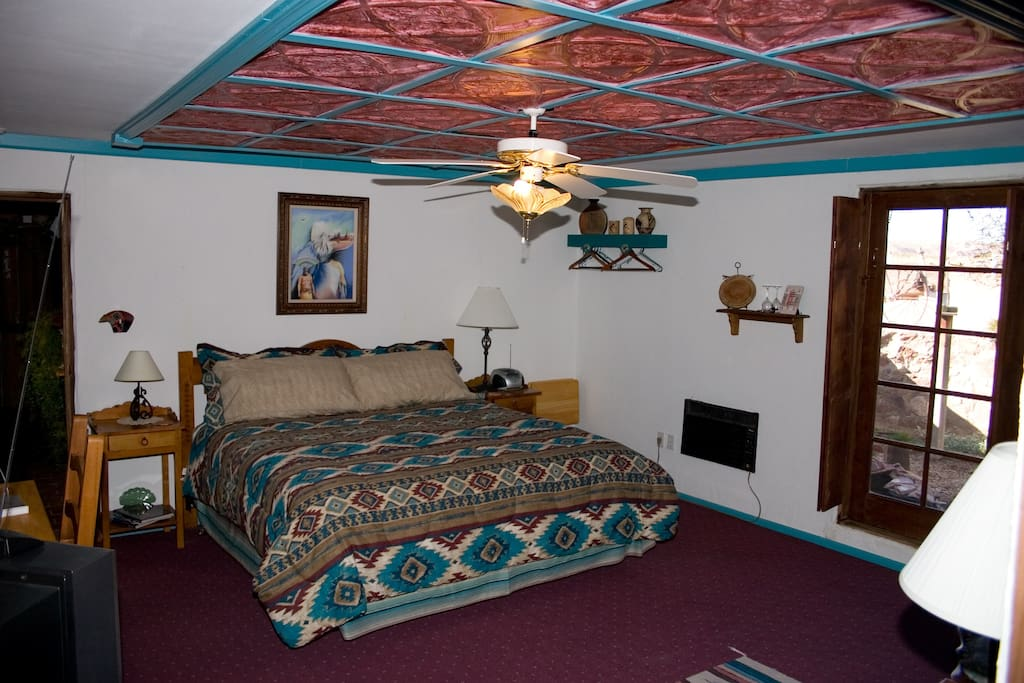Kokopelli has a king bed in the main room and a single bed in an alcove off the main room