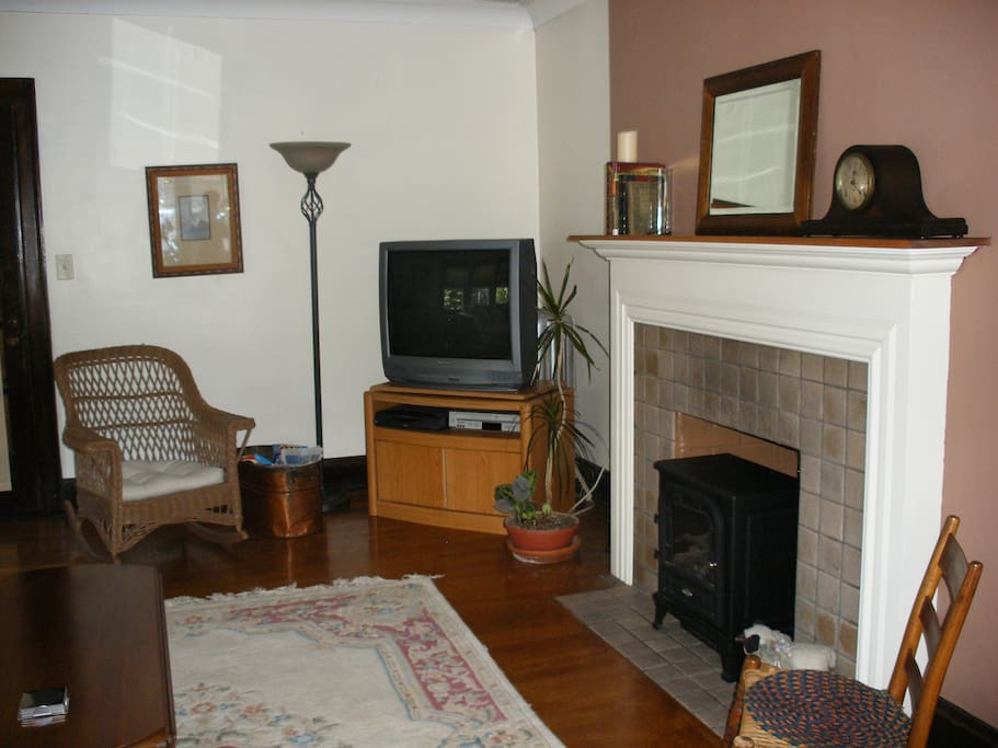 living room with fireplace accent and cable tv