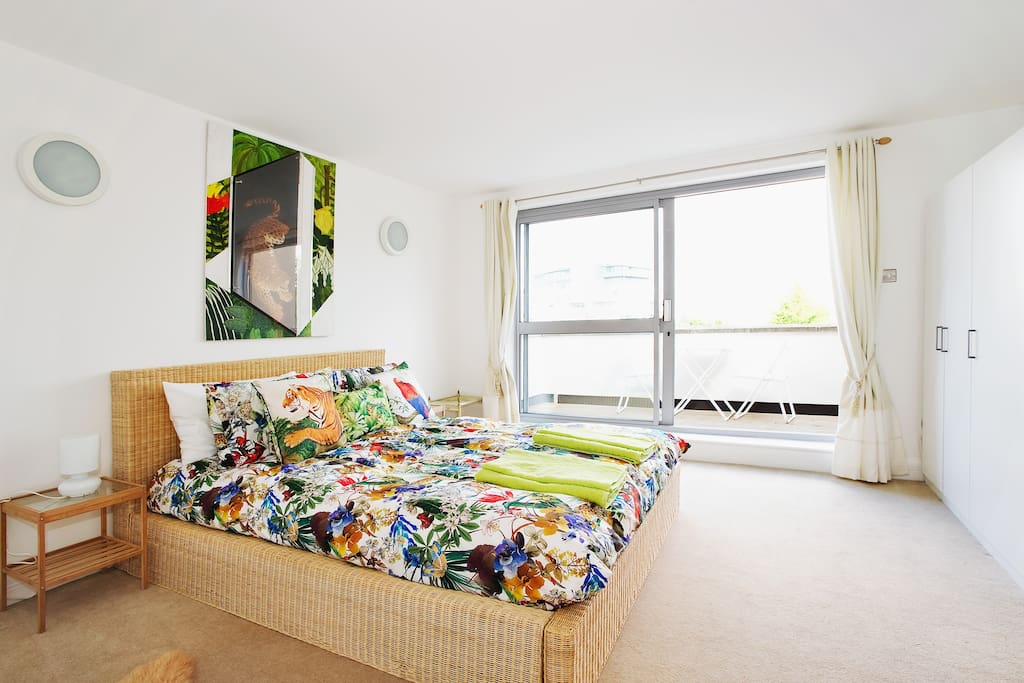 Bright, spacious master bedroom with it's own private balcony