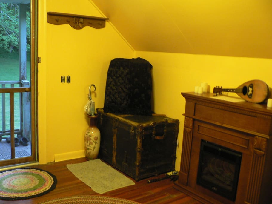 Electric fireplace and view of lawn with TV discreetly covered with velvet.