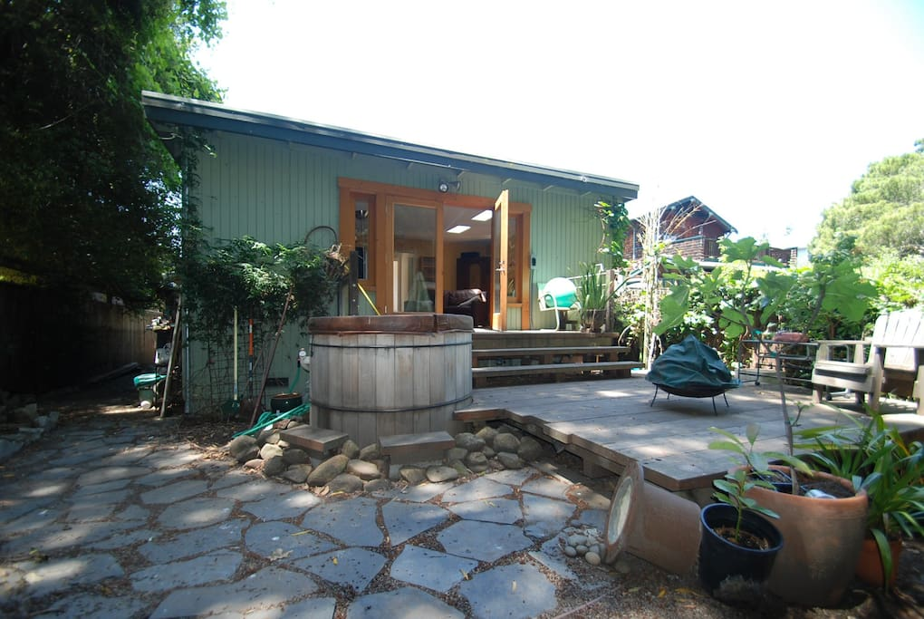 Private entrance, hot tub and deck.