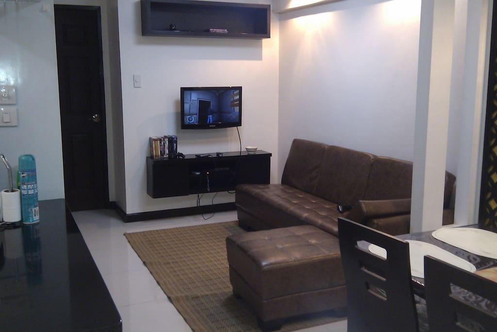 LIVING ROOM WITH TV SET. Don't you feel like you want to lie-down at the couch and browse the channels now?