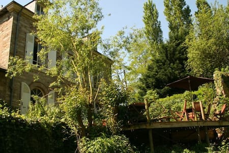 Beautiful old house in a beautiful wooded park with a river flowing just outside the house. Accommodates up to 12 people.