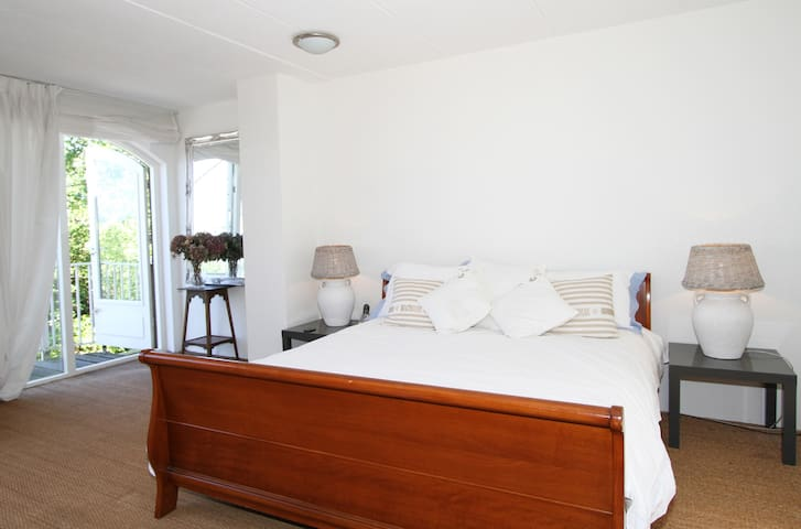 Bedroom 1, spacious with balcony and stairs to roof