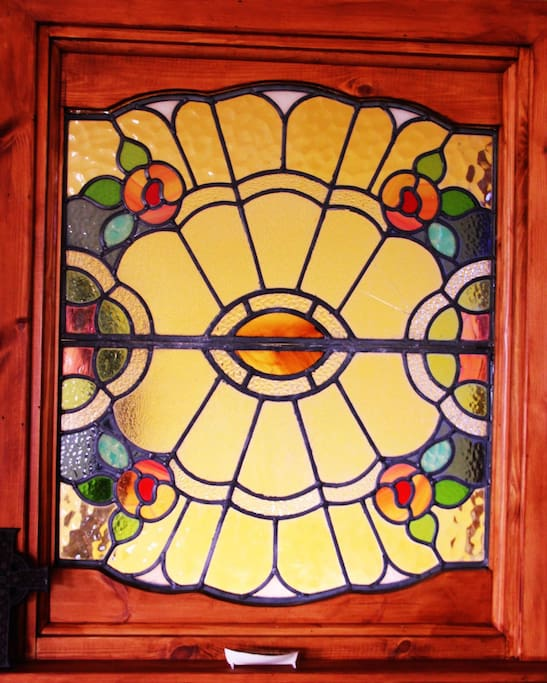This old stained glass window is typical of our decorative style.