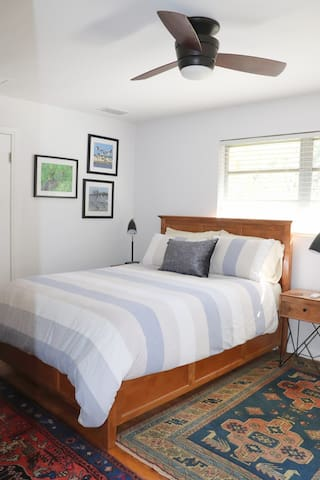 Queen-sized bed with 100% cotton bedding