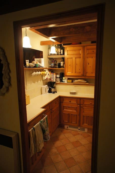 Galley kitchen with all the amenities, dishwasher, oven and fridge.