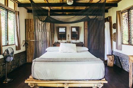The master bedroom, decorated with local crafts and materials