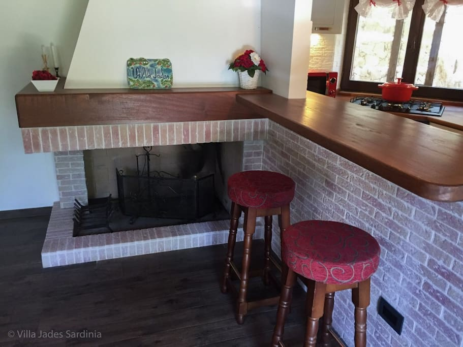 Front room, bar table, fire place