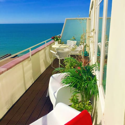 Beachfront Penthouse with private roof terrace