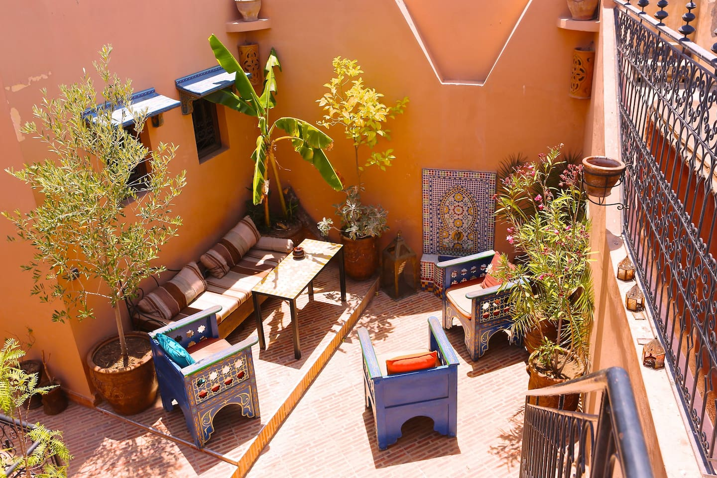 beautiful, rustic Moroccan outdoor seating on the rooftop terrace
