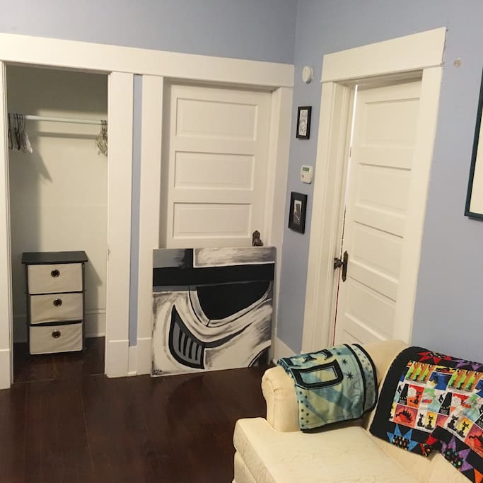 View to the right when you walk on. Door straight on does not open (hence the storm trooper). Door to the right leads to dining room. Love seat with blankets, closet with hangers, and 3 tier canvas drawers.