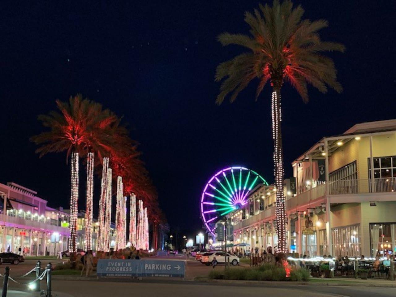 Main Street with Ferris Wheel, shops & restaurants.
