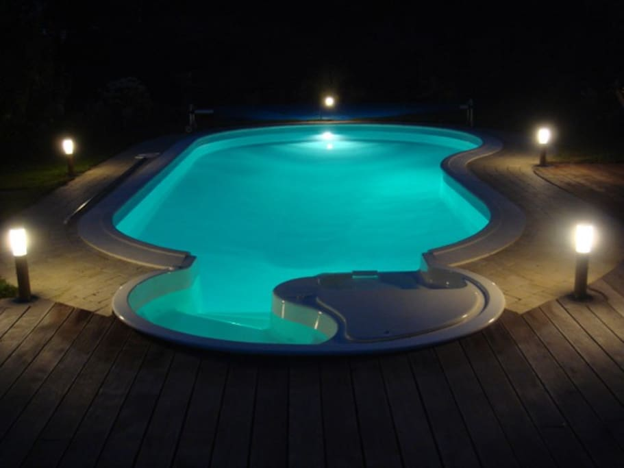 A heated swimming pool just aside to relax at the end of the day.