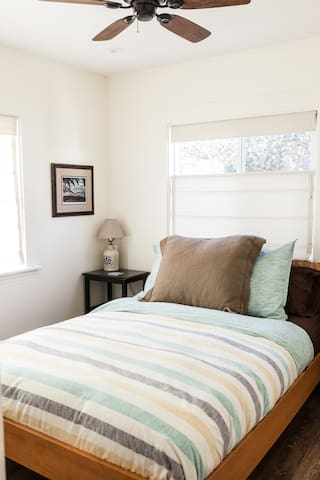 Front bedroom with ceiling fan