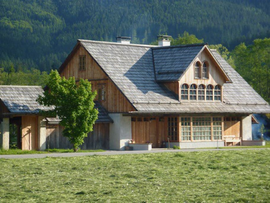Wooden walls and wooden tiled roof are reminiscent of a traditional mountain lodge