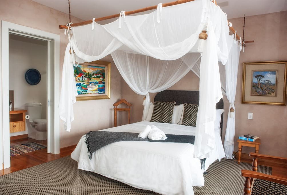 Inhluzani Suite - sleep on luxury Euro latex mattresses looking out over the mountains, deck, estuary and bay