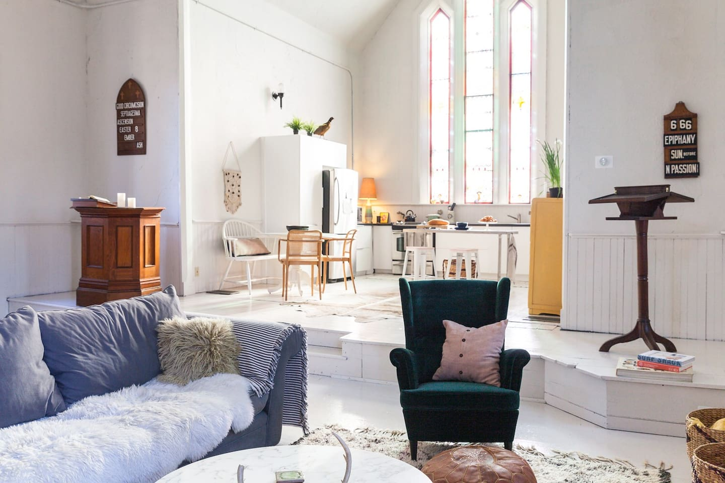 Original items from the chapel decorate the open-concept living space. (Photo: Lauren Kolyn)