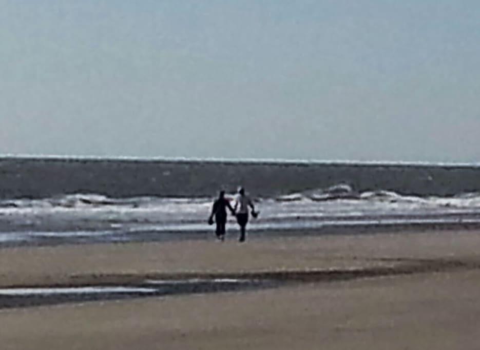 Walking on the beach in front of the Sonesta Resort.