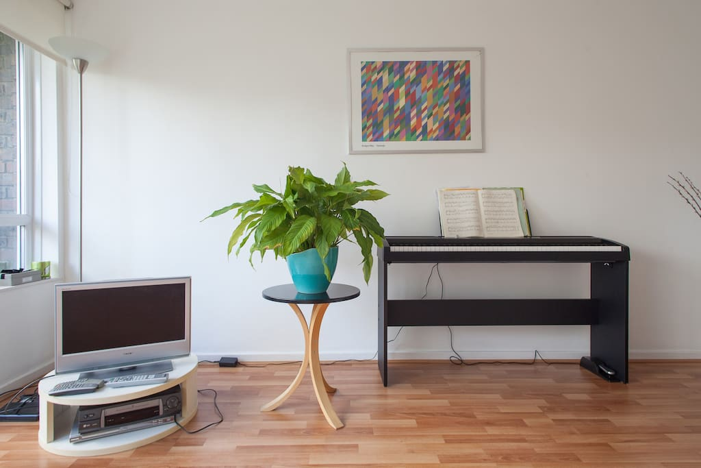 TV and piano in the living room